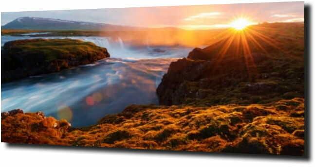 obraz na szkle Zachód słońca nad wodospadem