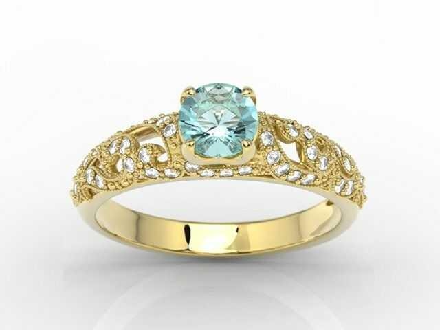 Pierścionek zaręczynowy z żółtego złota z topazem i cyrkoniami bp-50z-c
