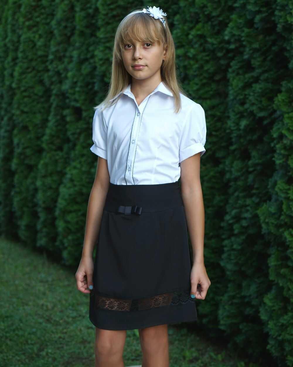 Klasyczna spódnica z koronką 122-152 sd14 czarna