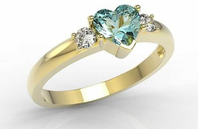 Pierścionek z żółtego złota z niebieskim topazem w kształcie serca i cyrkoniami jp-90z-c