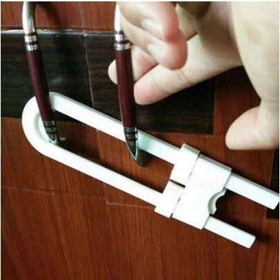 Blokada zabezpieczenie do szaf i szafek z uchwytami białe