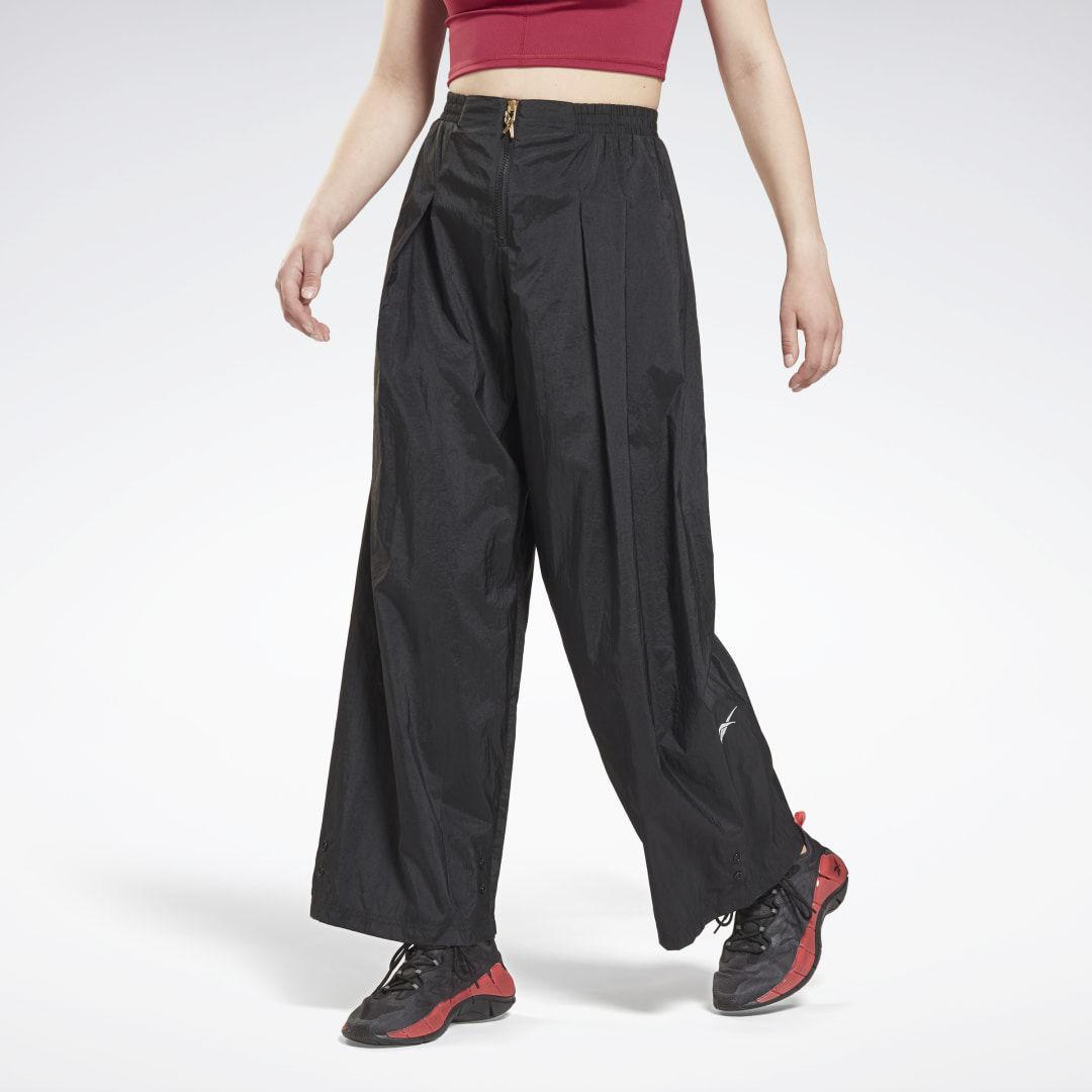 Reebok Spodnie z połyskującej tkaniny Studio
