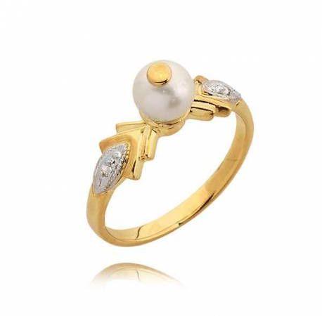 Efektowny pierścionek z cyrkoniami i perłą