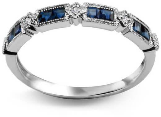 Staviori pierścionek. 5 diamentów, szlif achtkant, masa 0,01 ct., barwa h, czystość si1-i1. 8 szafirów, masa 0,38 ct.. białe złoto 0,585. szerokość obrączki ok. 3 mm.