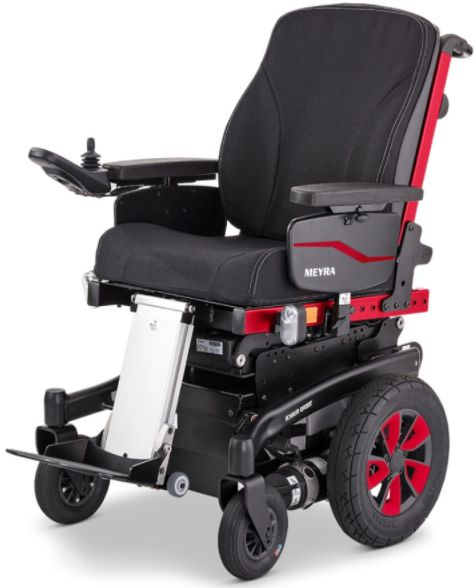 Elektryczny wózek inwalidzki z napędem środkowym - podnóżek centralny, tylne koło skrętne - duża zwrotność, łatwość manewrowania w pomieszczeniach, wy