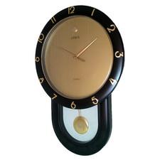 Zegar z wahadłem ze złotą tarczą