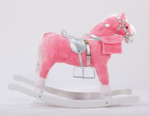 Różowy koń na biegunach z kokardkami w srebrnej uprzęży