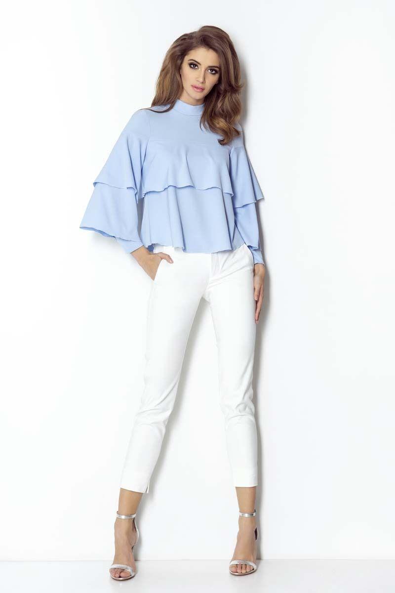 Białe spodnie cygaretki z rozporkiem na dole nogawki