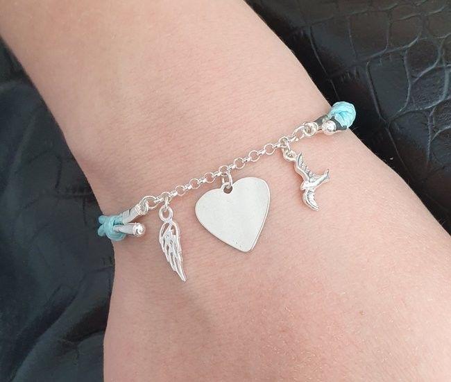 1151 bransoletka grawerowana srebrna na sznurku serce skrzydło ptaszek