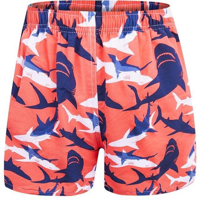 Szorty plażowe męskie pomarańczowe w białe i granatowe rekiny