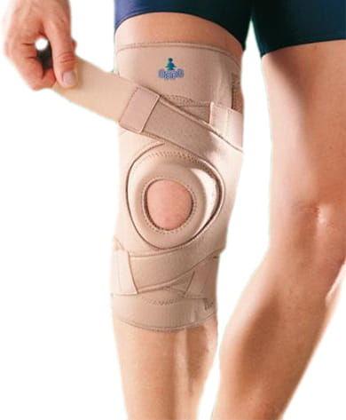 Stabilizator kolana z silikonowymi wzmocnieniami bocznymi oraz zapięciem krzyżowym 1033