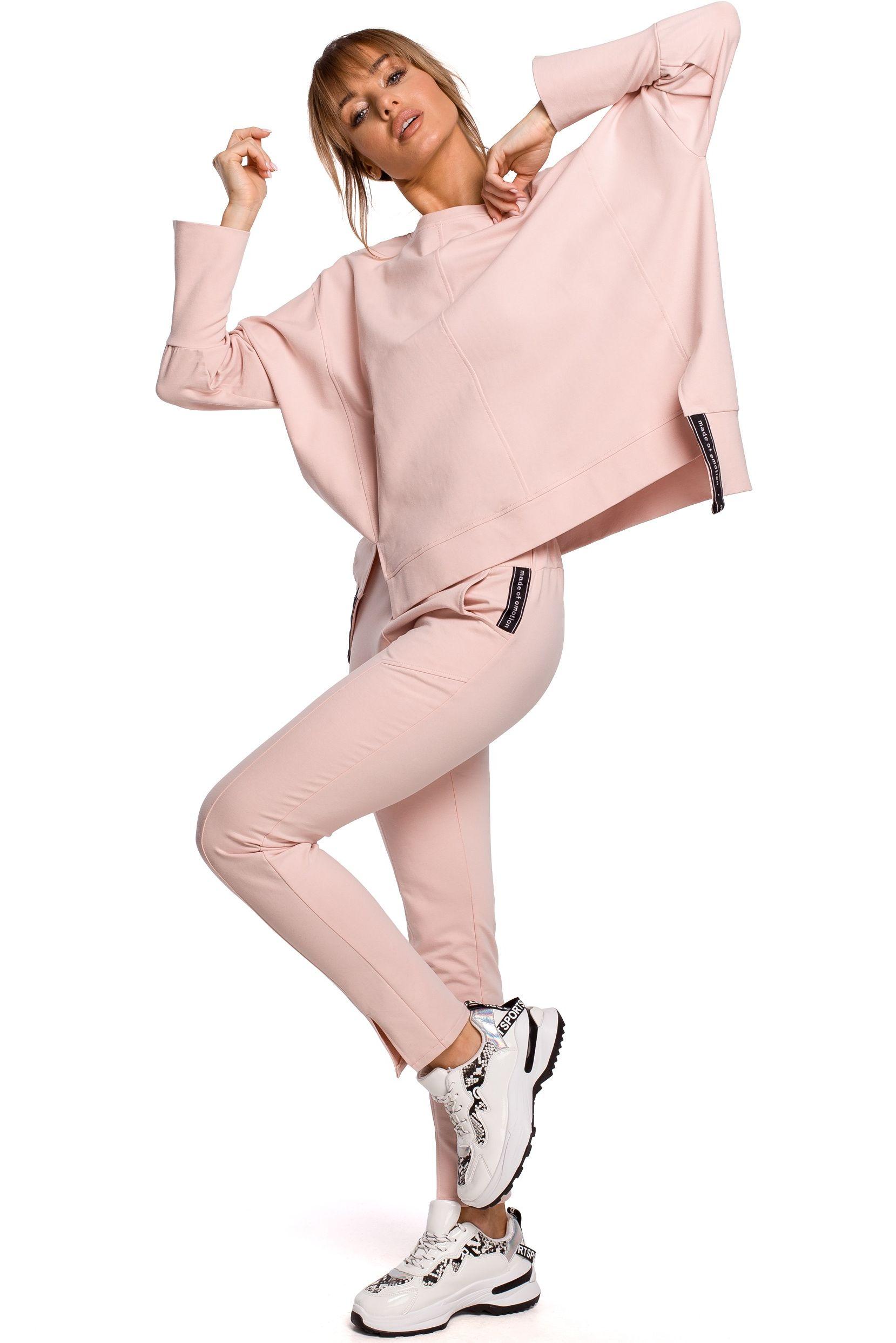 Dresowe spodnie z rozciętą nogawką - różowe