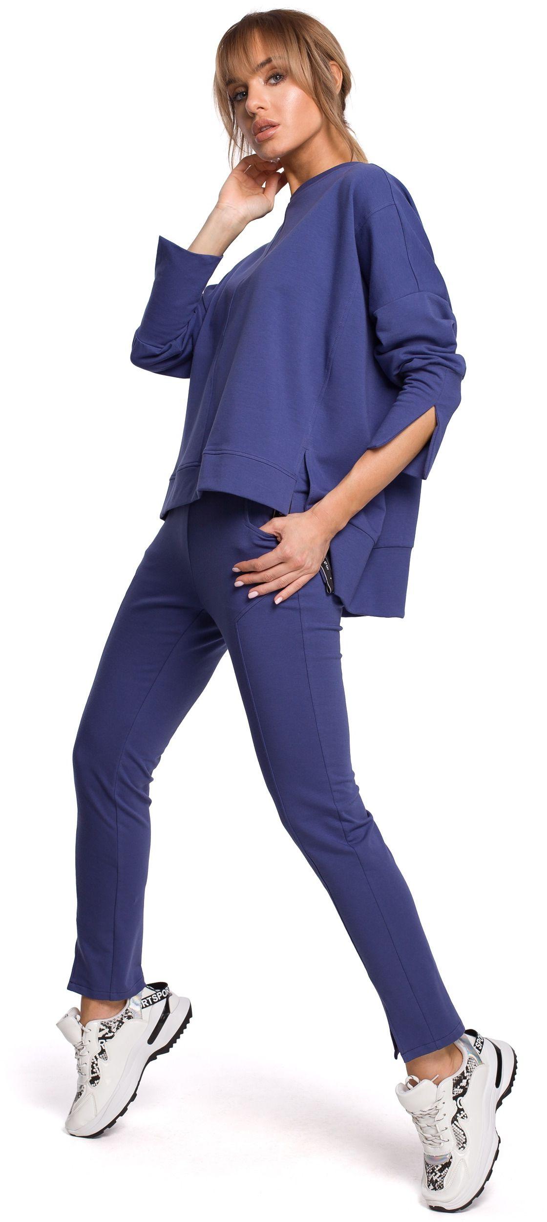 Dresowe spodnie z rozciętą nogawką - indygo
