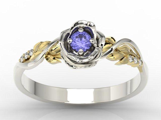Pierścionek złoty w kształcie róży z tanzanitem i brylantami lp-7715bz