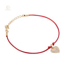 Bransoletka sznurkowa ze srebra pozłacanego serce z cyrkoniami