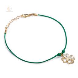 Bransoletka sznurkowa ze srebra pozłacanego koniczynka cyrkonie
