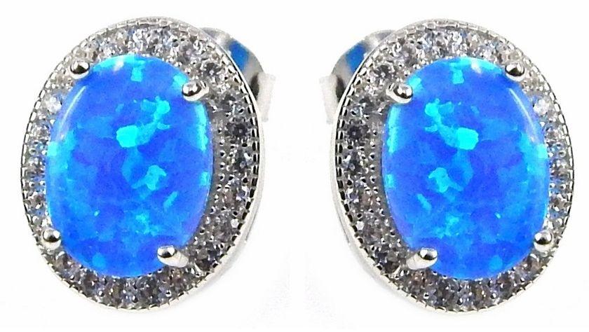 Owalne rodowane srebrne kolczyki sztyfty z niebieskim opalem i cyrkoniami