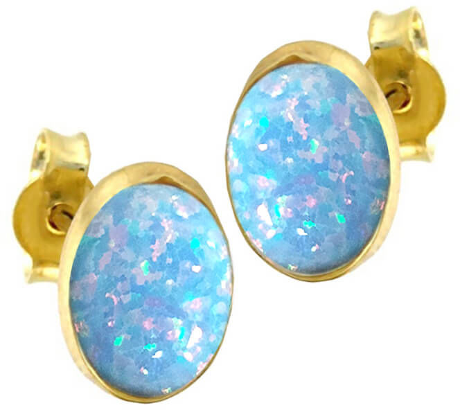 Złote owalne kolczyki sztyfty z niebieskim opalem