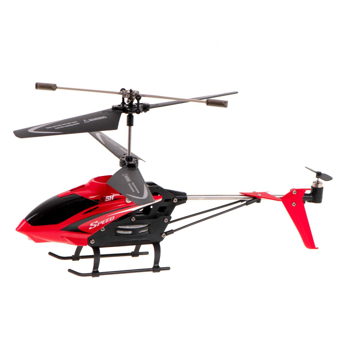 Niewielkich rozmiarów zdalnie sterowany helikopter w kolorze czerwonym